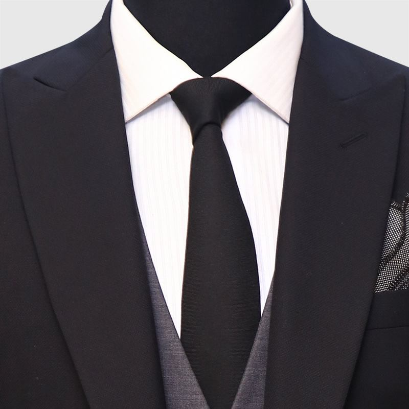 Black Suit And Waistcoat Detail